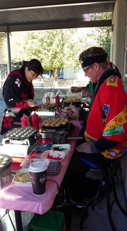 Tomomi Katz cooking takoyaki at her food booth